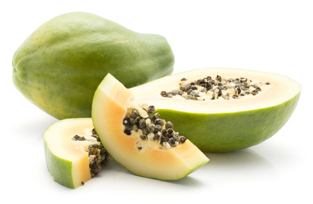 Sliced green papaya (pawpaw, papaw) isolated on white background one whole one half and two slices orange flesh with seeds Stock Photo