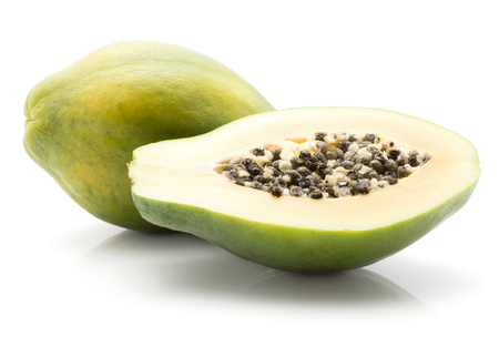 Papaya (pawpaw, papaw) isolated on white background one whole green and cross section half with seeds