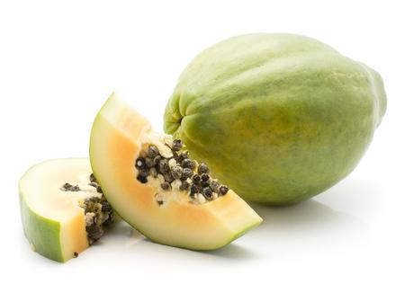 Green papaya (pawpaw, papaw) isolated on white background one whole and two slices orange flesh with seeds