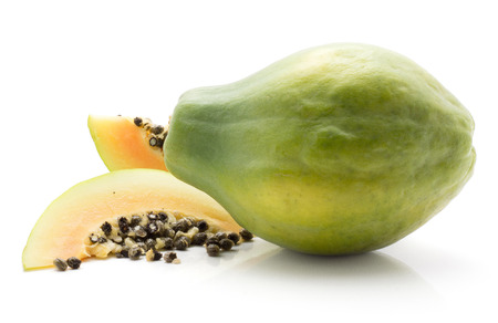 Green papaya (pawpaw, papaw) one whole two slices isolated on white background
