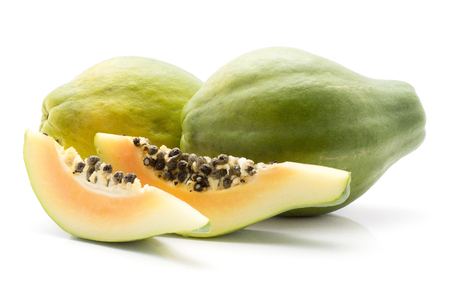Green papaya (pawpaw, papaw) two whole two slices with black seeds isolated on white background