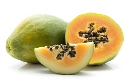 Green papaya (pawpaw, papaw) one whole half and slice isolated on white background