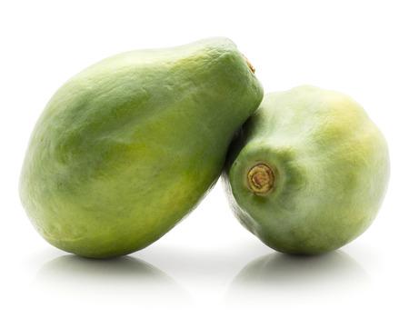 Two green papaya (pawpaw, papaw) isolated on white background fresh uncooked Stock Photo