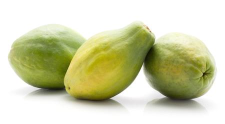 Three green papaya (pawpaw, papaw) isolated on white background
