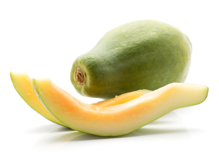 Green papaya (pawpaw, papaw) one whole and two slices without seeds isolated on white background