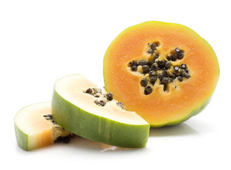 Green papaya (pawpaw, papaw) one half two slices black seeds isolated on white background