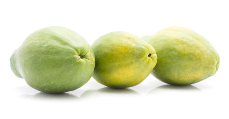 Three green papaya (pawpaw, papaw) in row isolated on white background  Stock Photo