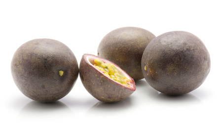 Passion fruits isolated on white background three whole one half