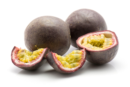 Passion fruit isolated on white background two whole one half two slices  Stock Photo