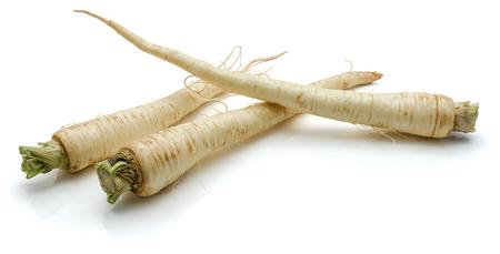 Three fresh parsley root isolated on white background Stockfoto