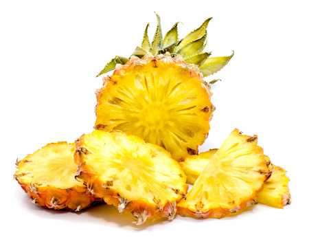 Fresh sliced pineapple with green leaves isolated on white background