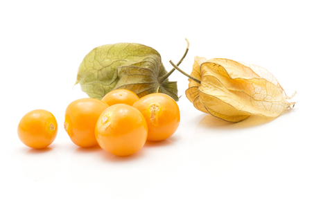 Physalis berries stack isolated on white background two in husk five orange  Stock Photo