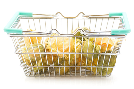 Physalis berries in a shopping basket isolated on white background