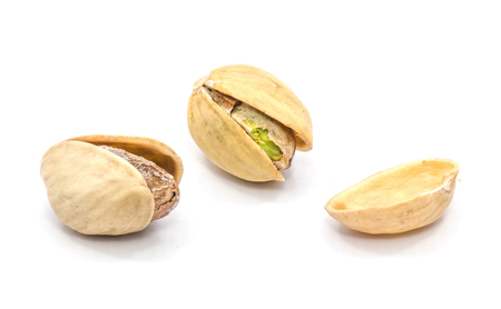Two whole open pistachio nuts, one shell half isolated on white background  Stock Photo