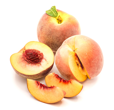 Peaches, one whole, one half and cut open, two slices, isolated on white background  Stock Photo