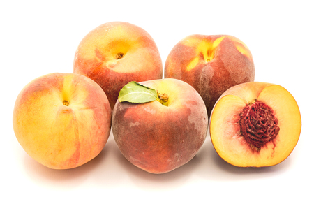 Group of whole peaches and one sliced half with a stone isolated on white background  Stock Photo
