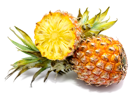 One whole and one pineapple half isolated on white background