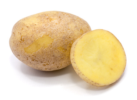 One whole potato and a slice isolated on white background