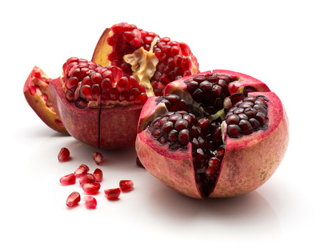 Two open pomegranate with revealed grains isolated on white background  Stock Photo