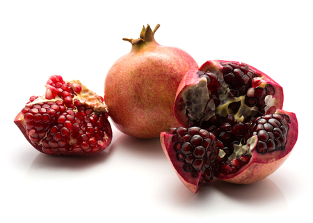 Pomegranate isolated on white background one whole and two open
