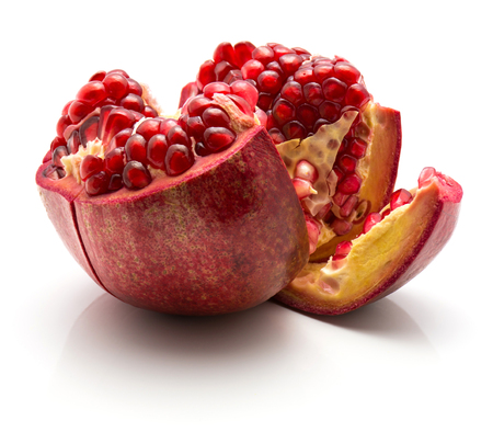 One open pomegranate isolated on white background
