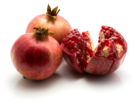 Three pomegranate isolated on white background two whole one open