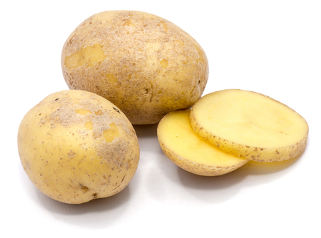 Two whole potatoes and two slices isolated on white background
