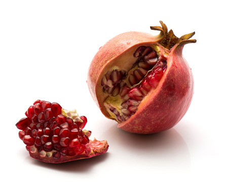 One open pomegranate and separated piece with grains isolated on white background  Stock Photo
