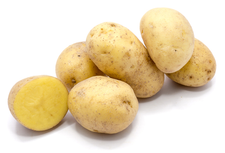 Group of whole potatoes and a half isolated on white background