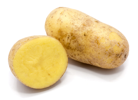 One whole potato and a half isolated on white background