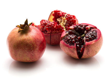 Pomegranate isolated on white background one whole two split open  Stock Photo