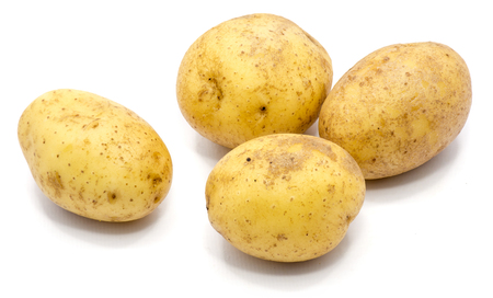 Four whole potatoes isolated on white background  Stock Photo