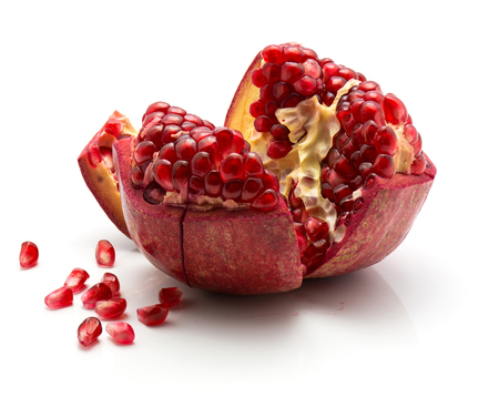 Open pomegranate with revealed grains isolated on white background  Stock Photo