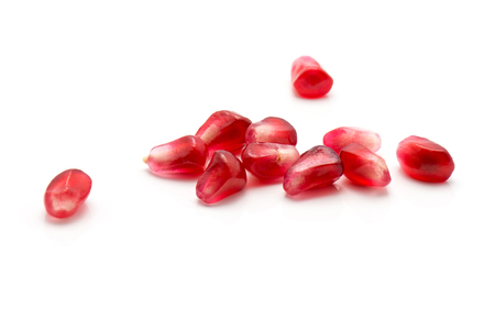 Pomegranate grains isolated on white background  Imagens