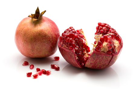 Pomegranate isolated on white background one whole one open separated grains