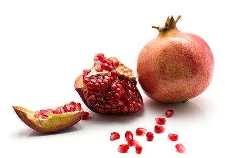 Fresh ripe pomegranate isolated on white background  Stock Photo