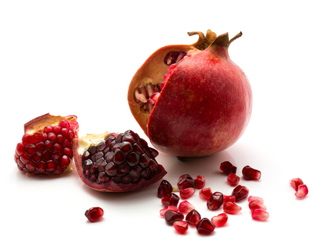 Open pomegranate with grains isolated on white background