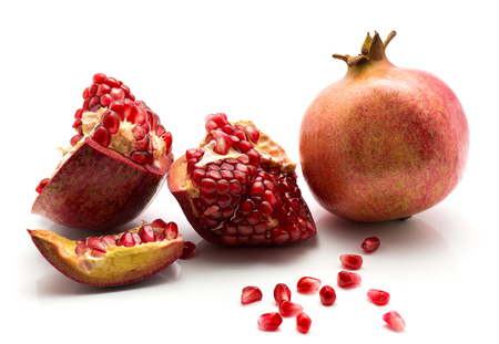 Pomegranate isolated on white background one whole parts and grains