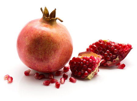 Pomegranate with revealed grains isolated on white background  Stock Photo