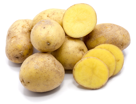 Group of whole potatoes with slices isolated on white background