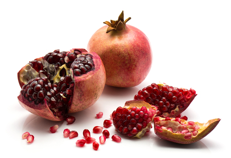 Split open pomegranate isolated on white background  Stock Photo