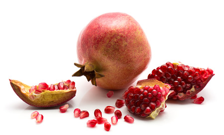 Fresh ripe pomegranate with revealed grains isolated on white background