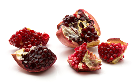 Five pomegranate pieces with grains isolated on white background