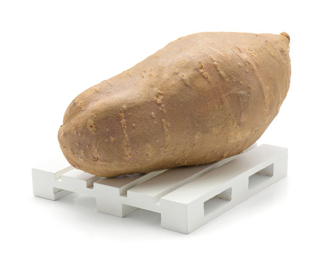 Sweet potato on a pallet isolated on white background one whole