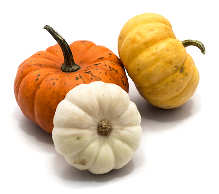Three whole colorful pumpkins (orange, yellow, white) isolated on white background  Stock Photo