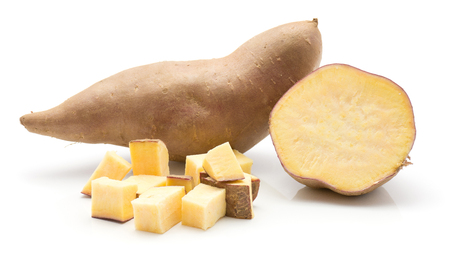 Sweet potato isolated on white background one whole one sliced half and chopped pieces  Imagens