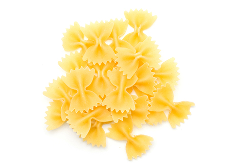 Raw farfalle pasta stack top view isolated on white background a lot of dry pieces