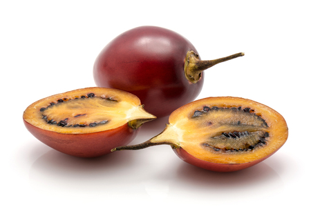 Tamarillo isolated on white background one whole and two sliced halves