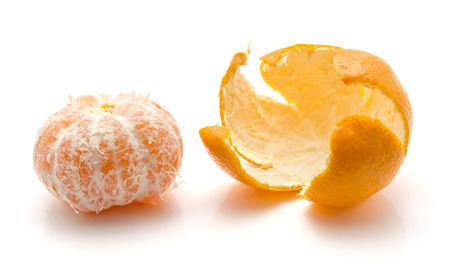 Peeled tangerine with separated rind isolated on white background