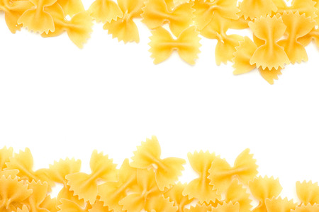 Raw farfalle top view isolated on white background hollow in the centre dry pasta pieces  Stock Photo